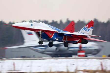 Kubinka, Moscow Region, Russia - June 19, 2015: Mikoyan Gurevich MiG-29 of Swifts aerobatics team taking off at Kubinka air force base. Redakční