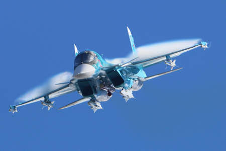 Zhukovsky, Moscow Region, Russia - August 30, 2015: Sukhoi Su-34 38 RED of russian air force perfoming demonstration flight in Zhukovsky during MAKS-2015 airshow.