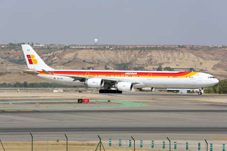 Madrid, Spain - August 12, 2015: Airbus A340-642 of Iberia airline taxiing at Madrid Barajas Adolfo Suarez airport.