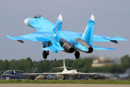 Kubinka, Moscow Region, Russia - June 20, 2015: Sukhoi Su-27SM RF-92210 jet fighter of russian air force takes off at Kubinka air force base. Redakční