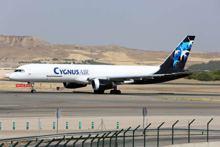 Madrid, Spain - August 12 2015: Boeing 757 of Cygnus Air airline taxiing at Madrid Barajas Adolfo Suarez airport.