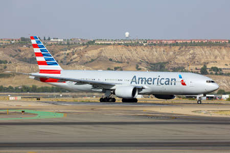 Madrid, Spain - August 12 2015: American airlines Boeing 777-200 taxiing at Madrid Barajas Adolfo Suarez airport.
