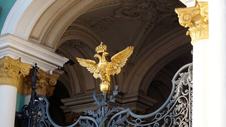 Fragment of the architectural design of the building is a symbol of the double-headed eagle,cast iron gate