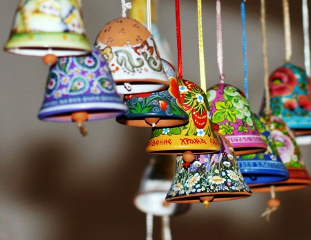 Bells made of clay, decorated with a pattern . photo