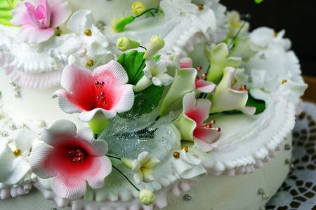 skillfully: The cake is skillfully decorated with flowers made of cream.