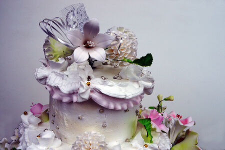 The cake is skillfully decorated with flowers made of cream.