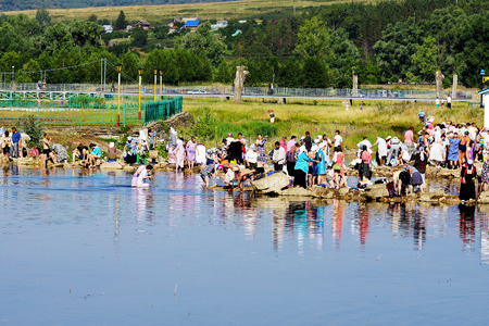 according to the scriptures: 5 July 2013 ,the city Krasnousolsk , Bashkortostan,Russia . The feast of the Tabynsk icon of the Mother of God - the main Shrine of the believers of the southern Urals and Orenburg regions, Pilgrims collect water and medical dirt from a Holy source.
