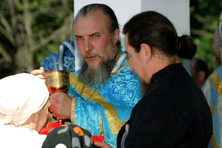 according to the scriptures: 5 July 2013 ,the city Krasnousolsk , Bashkortostan,Russia . The feast of the Tabynsk icon of the Mother of God - the main Shrine of the believers of the southern Urals and Orenburg regions, Pilgrims on the sacrament Editorial