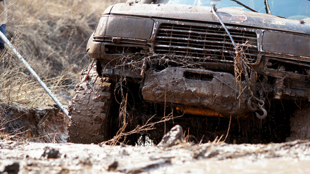 Extreme driving SUV to overcome the mud obstacles