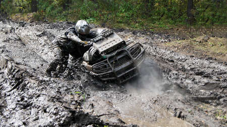 Extreme driving ATV on overcoming terrain.