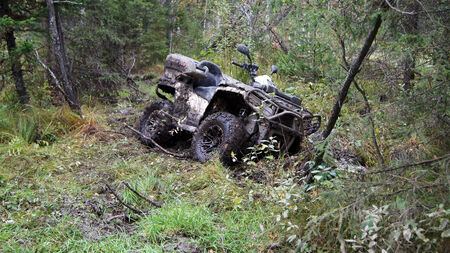 ATV stuck in the mud at overcoming mud obstacles. Stock Photo