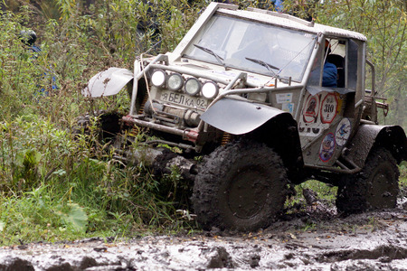 13.09.2014,Beloretsk,Bashkortostan,Russia,the second stage of the seventh championship of the Republic of Bashkortostan trophy-RAID Sargassi 2014 Extreme driving of the vehicle to overcome the lack of roads in the forest. Editorial