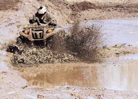 atv: Extreme driving ATV on overcoming terrain.