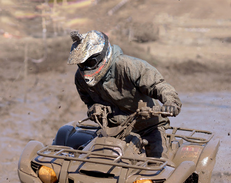 atv: Extreme driving ATV on overcoming mud obstacles.