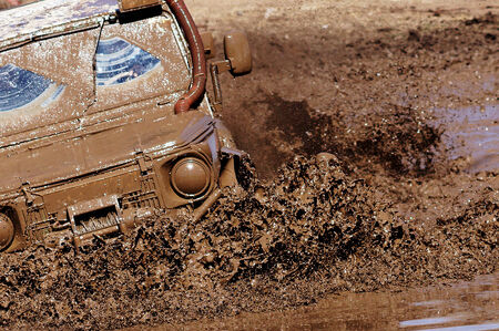 Extreme driving on overcoming mud obstacles.