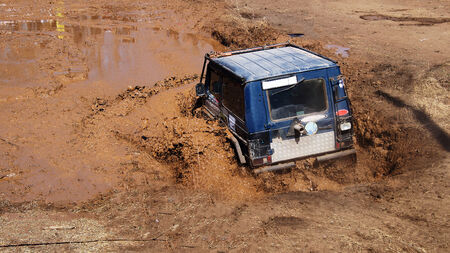 dirt: SUV overcomes obstacles dirt.