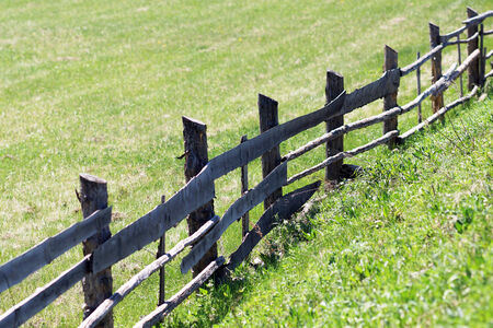 rickety: The old rickety fence with broken planks . Stock Photo