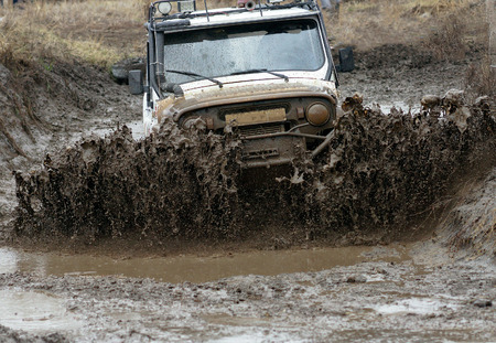 overcoming: Extreme driving on overcoming mud obstacles.