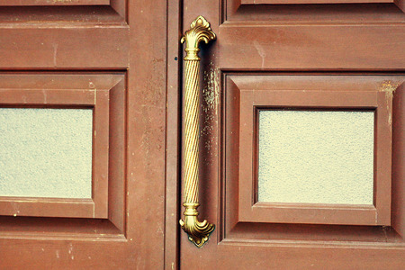 Not a new closed wooden door with a large metal handle.