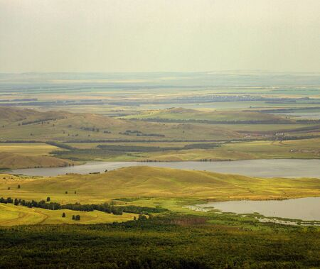 The lake is located at the foot of the mountains from the height of bird flight.