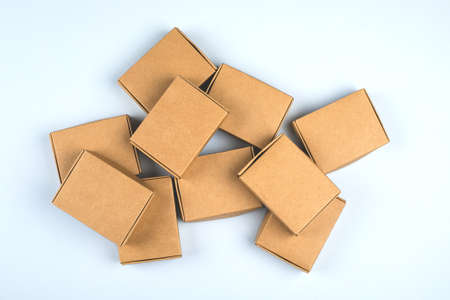 Paper boxes on light background. Top view, flat lay. Zero waste concept, eco gifts