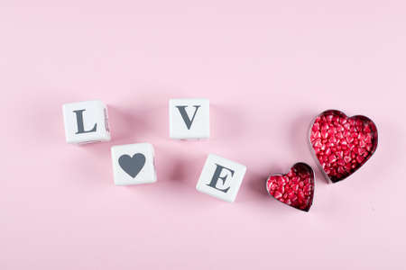 Heart Candy and Cubes Word Love. Valentine's Day Concept. Flat lay, top view, copy space