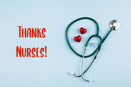 Thanks Nurses Card. Medical stethoscope, two red hearts. Healthcare medicine concept. Top view, flat lay.