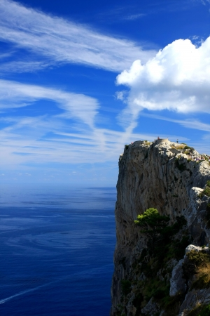 Cape formentor in the coast of mallorca  and the chemtrails on the sky ,balearic islands Stock Photo - 14352851