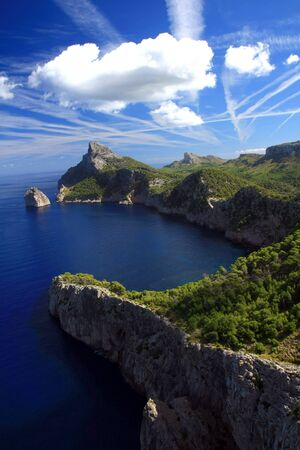 Cape formentor in the coast of mallorca  and the chemtrails on the sky ,balearic islands photo