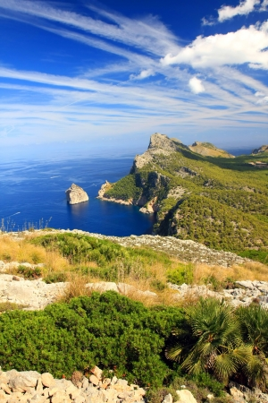 Cape formentor in the coast of mallorca  and the chemtrails on the sky ,balearic islands Stock Photo - 14351733
