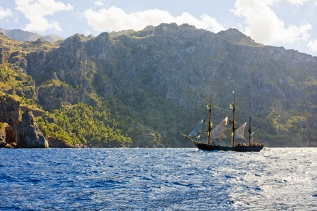 the amazing and wild coastline of Majorca island with a pirate ship, from movie  Atlas Cloud  photo