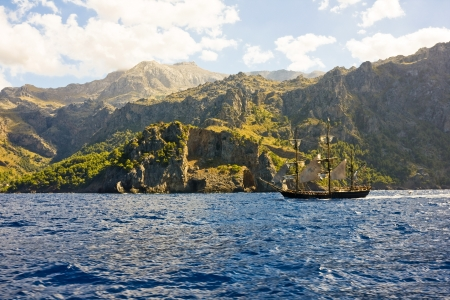 the amazing and wild coastline of Majorca island with a pirate ship, from movie  Atlas Cloud