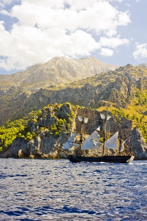 the amazing and wild coastline of Majorca island with a pirate ship, from movie  Atlas Cloud  Stock Photo - 14424525