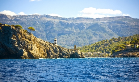 Port of Soller Lighthouse with amazing coastline in Majorca island, Spain Banco de Imagens