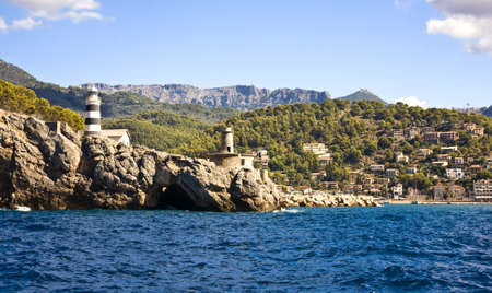 Port of Soller Lighthouse with amazing coastline in Majorca island, Spain photo