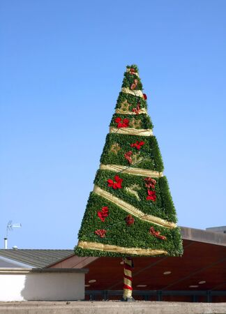 Decorated Christmas tree on blue sky background  photo