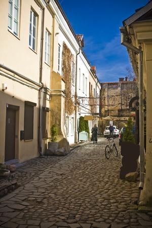 vilnius: Vilnius oldtown street in sunny day Stock Photo