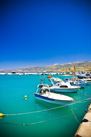 Sea bay with moored boats, promenade in Mediterranean town Sitia Greece Crete Stock Photo - 18120339