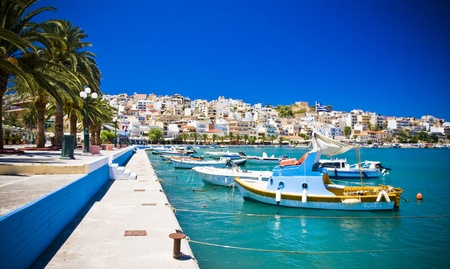 Sea bay with moored boats, promenade in Mediterranean town Sitia Greece Crete Stock Photo - 18120444