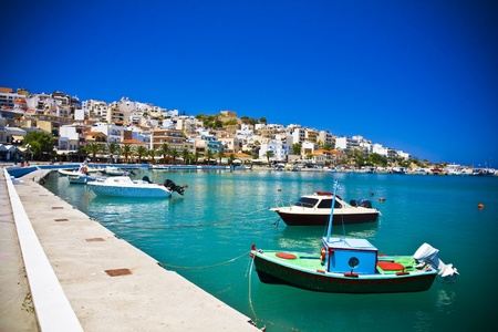 Sea bay with moored boats, promenade in Mediterranean town Sitia Greece Crete Stock Photo