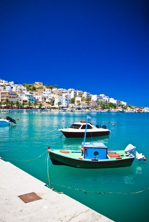 Sea bay with moored boats, promenade in Mediterranean town Sitia Greece Crete Stock Photo - 18120340