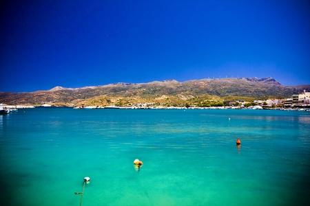 Sea bay with moored boats, promenade in Mediterranean town Sitia Greece Crete Stock Photo - 18120353