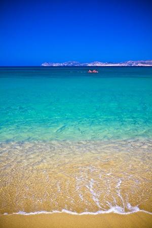 Sea bay with moored boats, promenade in Mediterranean town Sitia Greece Crete Stock Photo