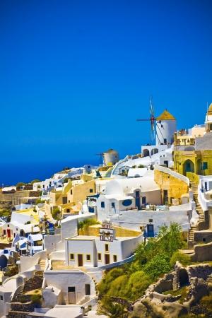 santorini caldera: Colorful village of Oia at Santorini island in Greece Stock Photo