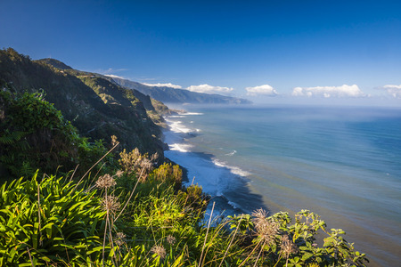 View of beautiful mountains and ocean on northern coast near Boaventura, Madeira island, Portugal