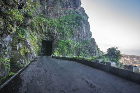 dangerous road: Empty dangerous road just before the sunset in Madeira island, Portugal Stock Photo