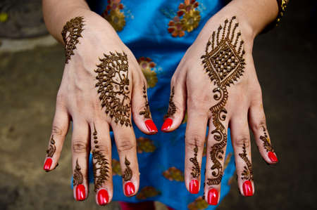Beautiful Indian artwork of applying Henna on Wedding celebrations photo