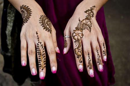 Beautiful Indian artwork of applying Henna on Wedding celebrations