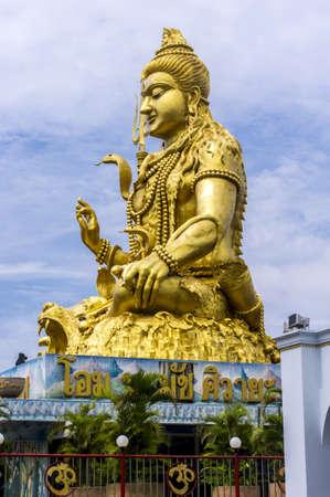 mahadev: BANGKOK - SEPTEMBER 27 Towering golden statue of Deity Shankar on September 27, 2012 in Bangkok Thailand. The statue  is in a Shiva temple located at Minburi
