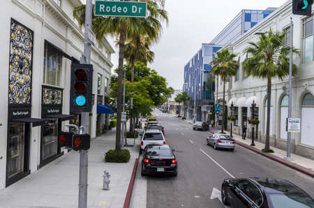 Beverly Hills, California - June 9th, 2013 : Rodeo Drive of Beverly Hills, California is the exclusive shopping area with the most sought after luxury designer stores of the world.